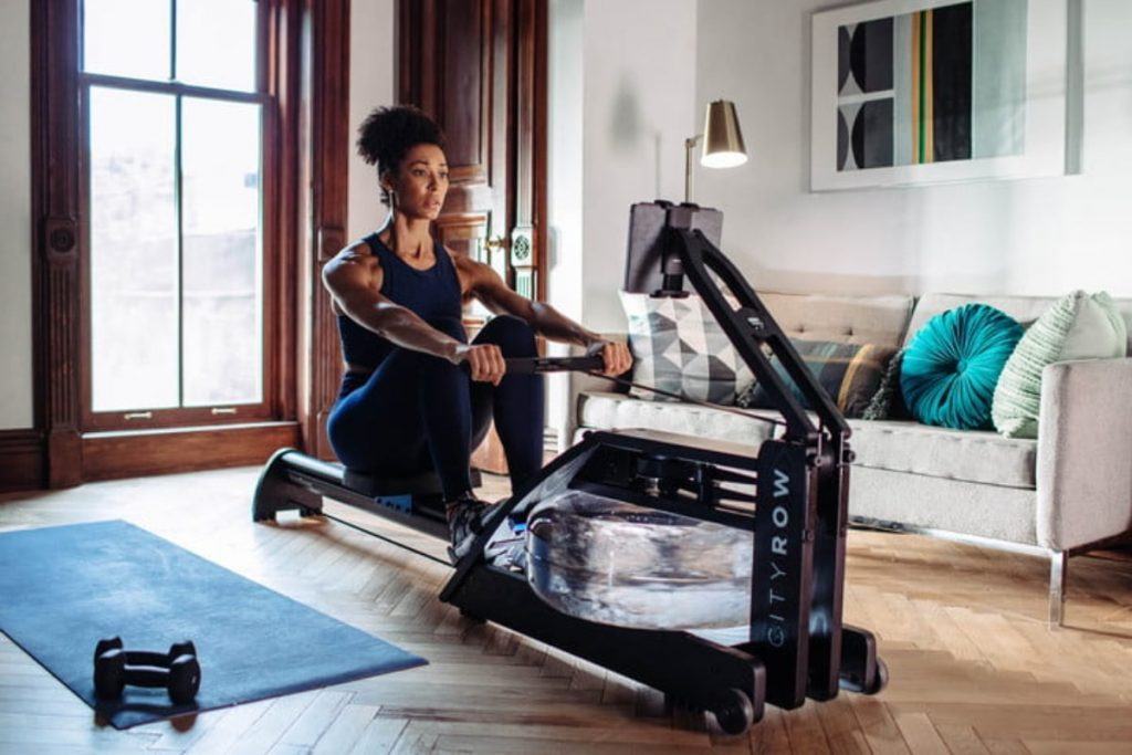 woman working out with cityrow go max smart rower